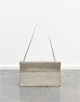 Genzken studied at the Hamburg University of Fine Arts and Düsseldorf Art Academy, and made her debut with the floor-placed abstract sculpture <i>Ellipsoids</i> while still a student. Since then she has remained a leading figure in German contemporary art. Her sculpture made of concrete representing a radio, exhibited here, is one of a series she began in 1982. It celebrates the beauty of the industrial, and shows its unique presence as an architectural construction.